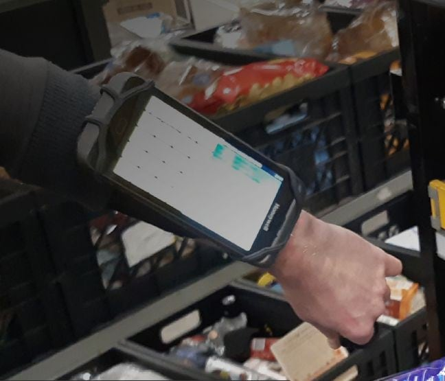 worker wearing Honeywell mobile computer on arm band